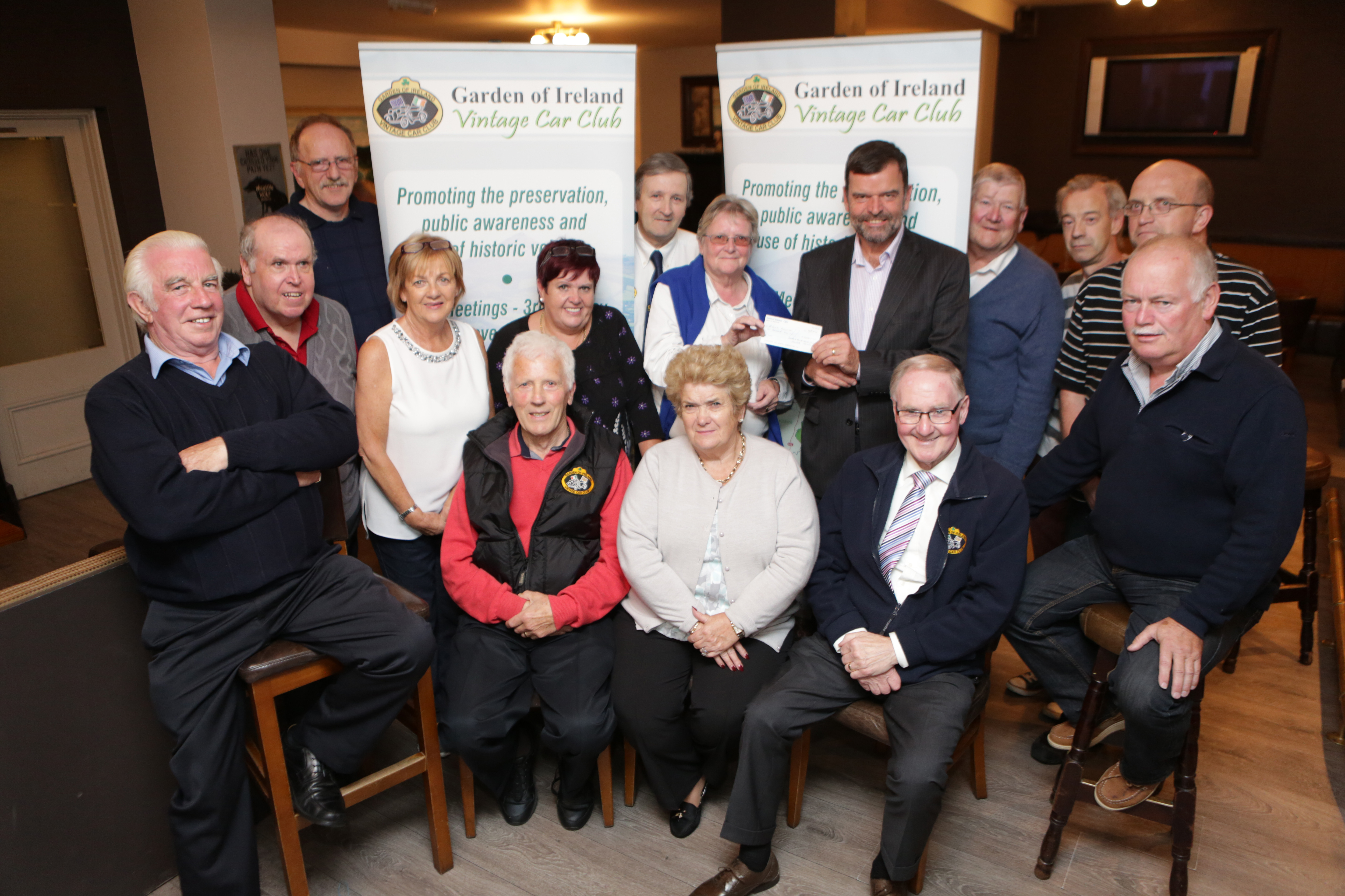 The Garden of Ireland Vintage Club present the cheque of the proceeds from the Tom Kennedy Memorial Car Show to St Vincents Foundation: Eileen Kennedy presents the cheque to John Hickey CEO